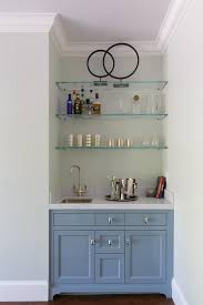 blue wet bar cabinets with glass shelves