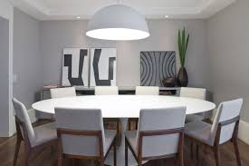 large round white dining tables upholstered chairs laminate floor