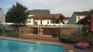 home pool tiki bar. JPG Custom-built-Tiki-Bar-by-Pool Home Pool Tiki Bar S