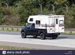 Dodge RAM 2500 pickup truck with a Fleetwood Elkhorn camper cabin ...