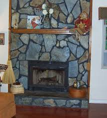 and a picture of the fireplace before and after it was converted from wood burning to gas much more light in the living room now