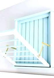 wall mounted folding drying rack fold down drying rack wall mounted accordion drying rack white fold