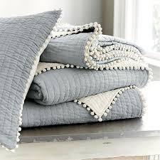 Ballard Designs blue-grey quilt with ivory pom pom trim. Check out ... & Ballard Designs blue-grey quilt with ivory pom pom trim. Check out more  playful Adamdwight.com