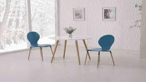 round white wooden dining table and 4 blue chairs set