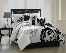 black and white queen comforter contemporary in style with attractive pictorial features equipped with brown table
