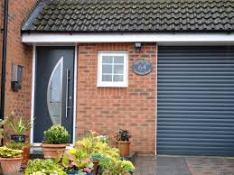hormann thermopro entrance door style 900 in anthracite grey ral 7016 with matching roller garage door