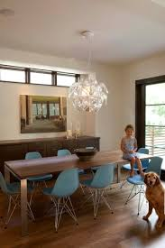 contemporary dining room with a pop of color love the chairs