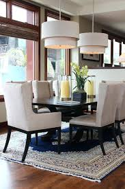 dining room captain chairs inspired dining chair in dining room transitional with double chandeliers next to