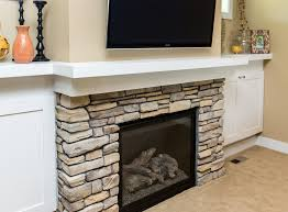 modern built ins on each side of a lennox gas fireplace surrounded in stone
