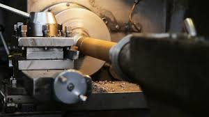 machining wallpaper. facing operation of a metal blank on turning machine with cutting tool. old lathe in workshop. operator machining high precision wallpaper
