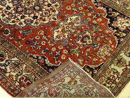 rare antique isfahan rug ivory border cinnabar red