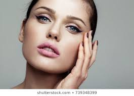 cat eye eyeliner makeup flawless woman close up beauty shot of young pretty model with bright make up eyeliner