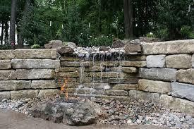 limestone wall waterfall boulder fire pit