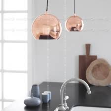 frandsen glossy copper ball pendant lamp seen with other lamps