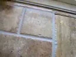 how to grout travertine tile floor installation without clogging fisher holes you