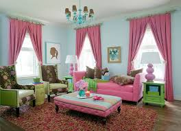 traditional living room benefits from an infusion of pink and green from tobi fairley
