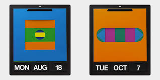 the simple set up consists of a metal frame with cards to display the day of the week month and date alongside six reversible bi colour cut out sheets