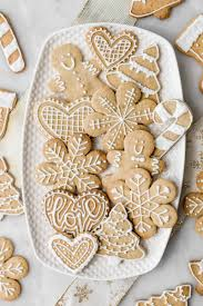 I found a ton of cute ideas for decorating santa cookies, reindeer cookies, angel sugar cookies and more. Decorated Christmas Cookies Cravings Journal
