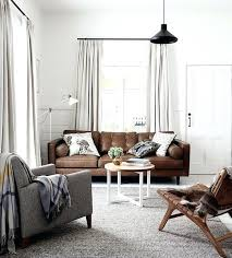 gray walls brown couch clean white chic ways to style a sofa in your living room gray walls brown couch