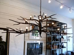 rustic model and dark color near fixture lighting for branch chandelier installed from white ceiling color inside living room with industrial floating shelf