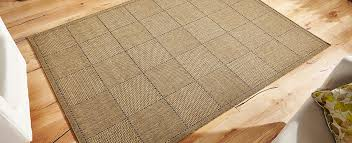brown rug with a thin pile