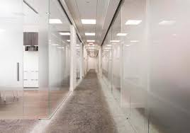 glass partition walls create a dynamic