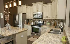 beautiful kitchen in ocean springs ms includes custom built white cabinets with granite countertops