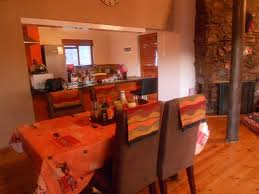 chandelier game lodge ostrich show farm open plan kitchen dining area at the
