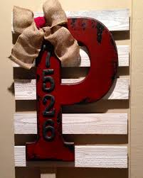 monogram and street address metal numbers both on from hobby lobby repurposed pallet wood free with a little white spray paint some burlap and