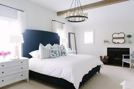 white and navy bedroom with fireplace view full size