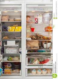 open refrigerator in kitchen. royalty-free stock photo. download open refrigerator in kitchen
