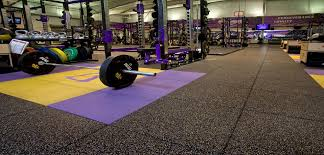 multi color rubber gym floor mats with big sport equipments in white painted gym wall