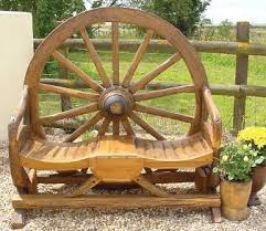 This wagon wheel garden bench took many hours to complete, but I'm satisfied