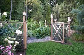A Cedar Decorative Fence and Birdhouses Surround an Organic Vegetable Garden  - Gayle Burbank Landscapes
