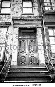 city apartment building entrance. typical entrance door to a new york city apartment building residential home - stock photo m
