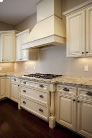 Kitchen ideas cream cabinets Worktop Love The Antiqued Cream Cabinets And Light Countertop Combo Pinterest Love The Antiqued Cream Cabinets And Light Countertop Combo For