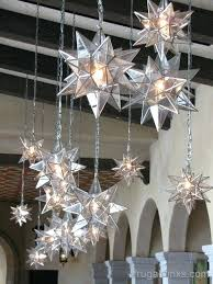 moravian star chandelier love the diffe sizes and the light and glass mixed with the dark wood beams in the background star pendents grouped at la