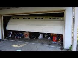 garage door off trackCar Crashes Garage Door Off Track  Emergency Closure  YouTube