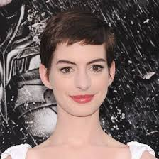 with her gamine crop porcelain skin and doe e makeup anne hathaway bears a striking resemblance to audrey hepburn but at last night s the dark knight