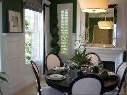 inspirative black dining room sets with black round table and decorative ceiling lamp and large mirror