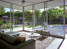 Example of a large minimalist concrete floor and gray floor sunroom design  in Austin with a