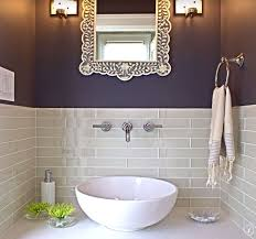 contemporary powder room with limestone counters vessel sink subway tile designer white solid