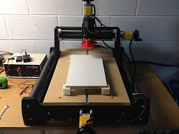 diy cnc machine with blocks and red dust boot