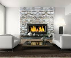 stacked split face stone on fireplace from daltile arctic gray beach ledge random sized wall cladding