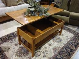 The highlight of this cleverly designed and crafted piece is the solid wood table top that can be elevated, allowing you to use it as a stable work area or for holding a laptop computer. Classic Mission Rectangular Coffee Table With Lift Top From