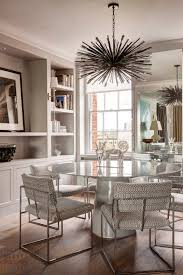 rounded glass top table decor with beaded chandelier in white dining room modern contemporary dining room