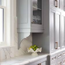 gray cabinets with gray corbels