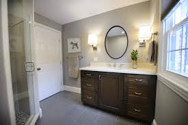 here is a closer looks at the vanity wall vignette we chose a dark stain for the cabinetry to complement the white stone top