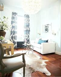 faux cow skin rug wonderful cowhide rug with white sofa design a green way faux cow skin rug
