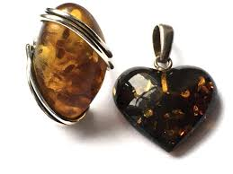 baltic amber set vintage ring with cognac amber and a big heart pendant made of